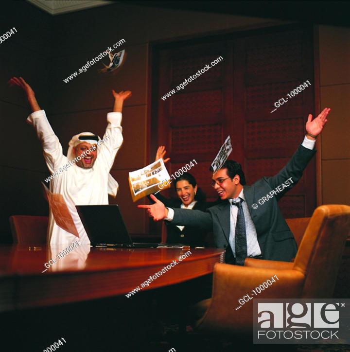 Stock Photo: Jubilating Arab businesspeople.