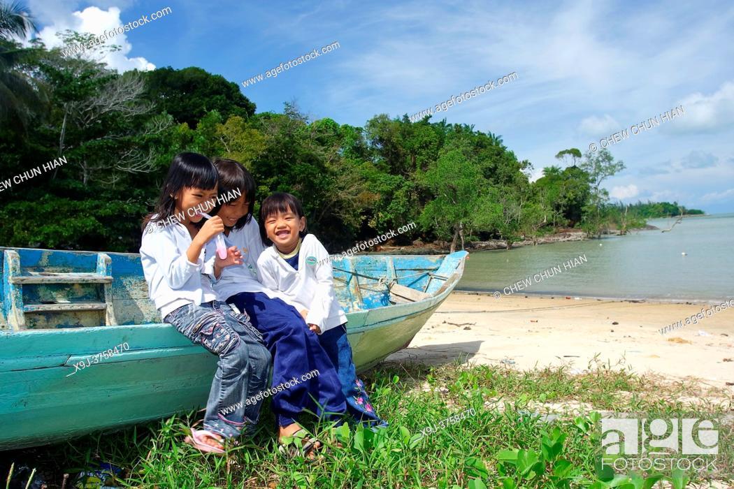 Stock Photo: appy child group playing on beach, kuching, sarawak, malaysia, asia.