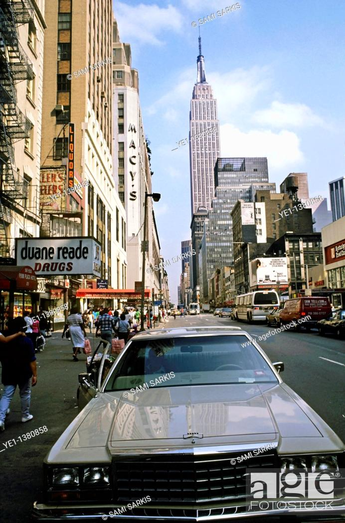 Stock Photo: Car parked in a downtown street with the Empire State Building in the background, Manhattan, New York, USA.