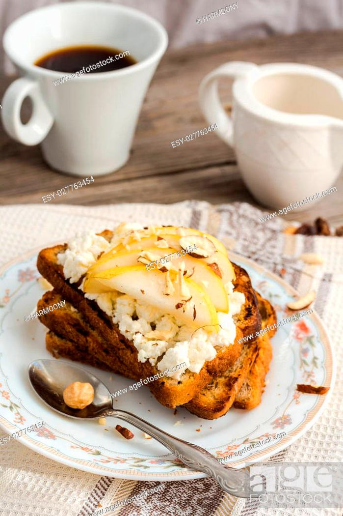 Stock Photo: crisp toast for breakfast with sweet cream cheese and pear, a cup of coffee, rustic.