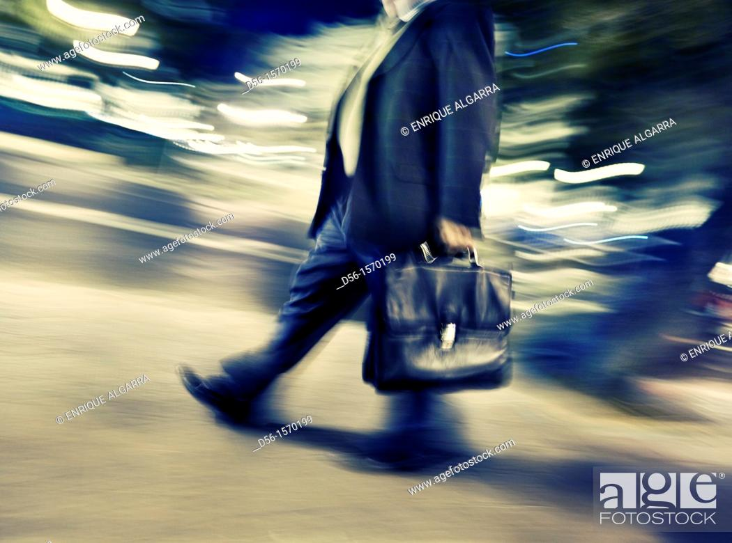 Stock Photo: man walking with briefcase.