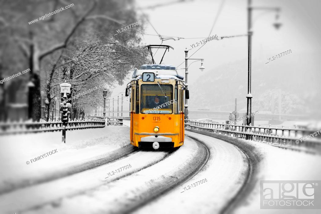 Stock Photo: Traditional Yellow Budapest tram in the snow.