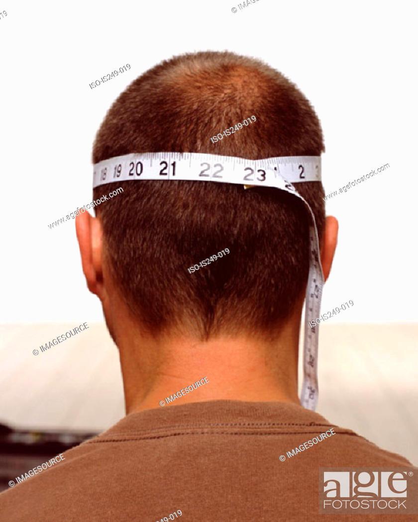 Stock Photo: Measuring male head.