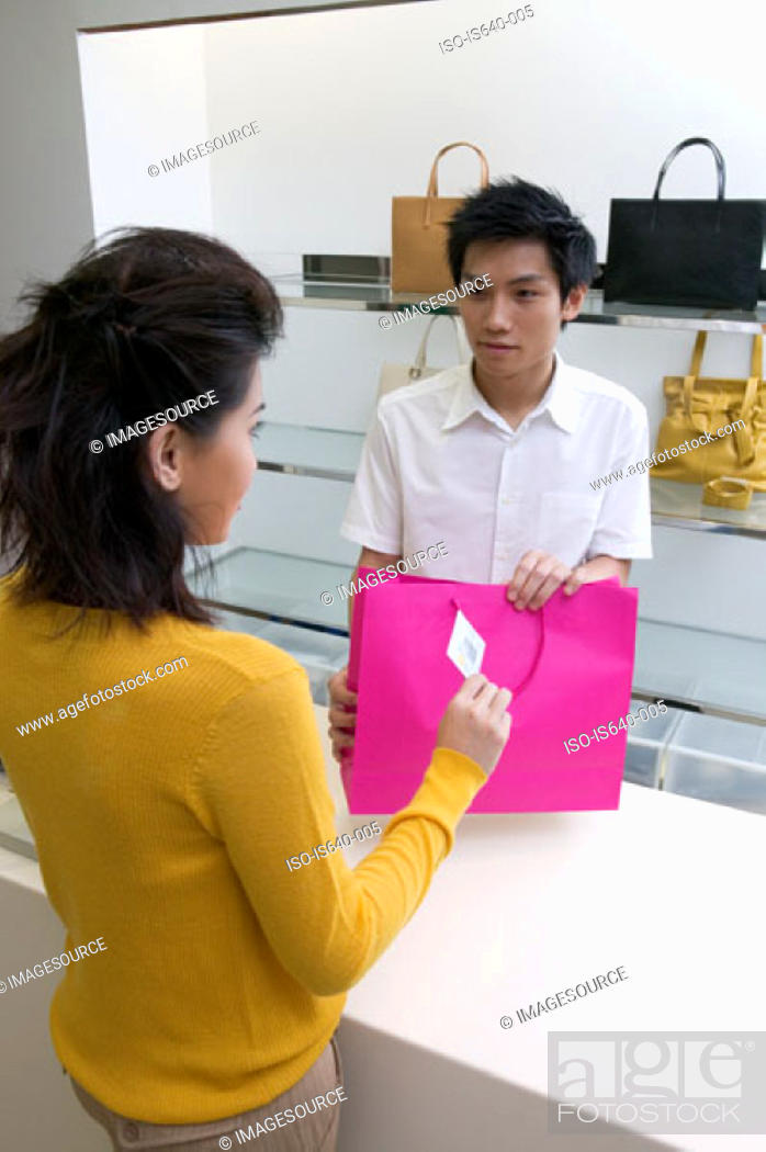Stock Photo: Woman buying handbag.