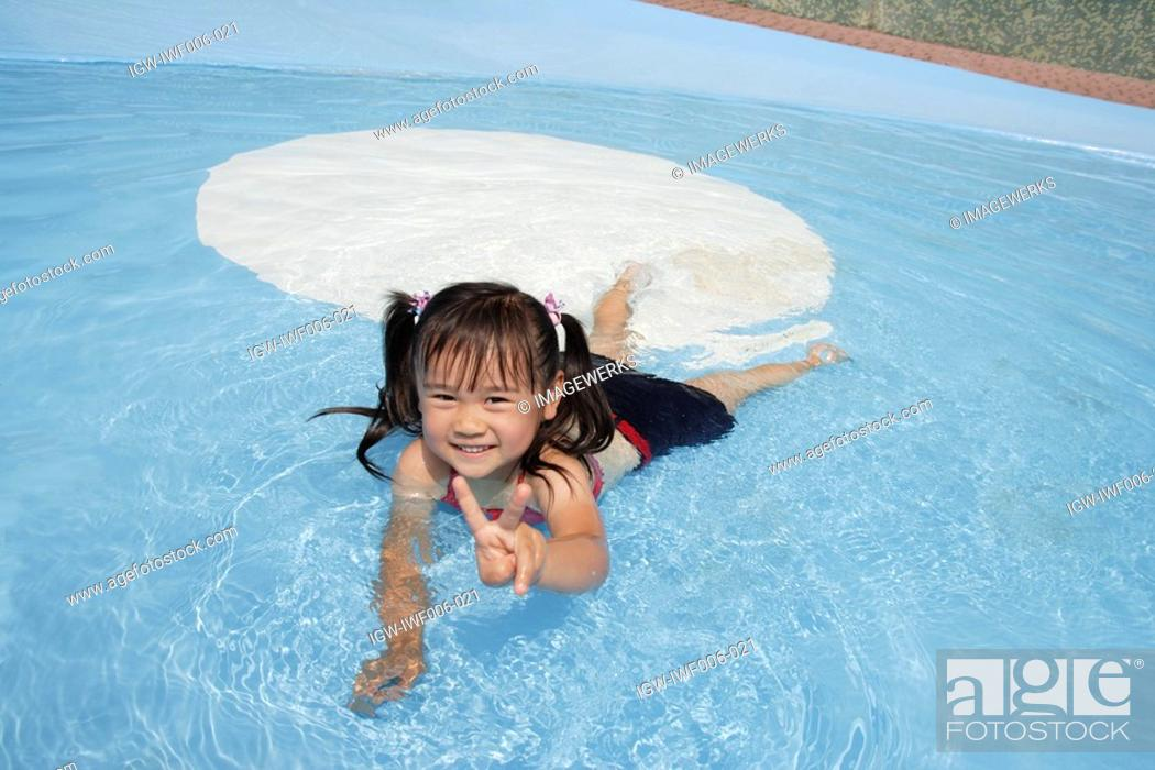 Stock Photo: A girl in a pool.