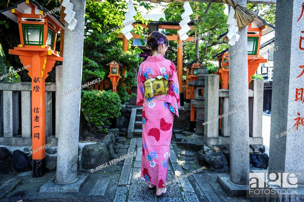Stock Photo: Tourist dressed with kimono on the streets of Kyoto, Japan, Asia.