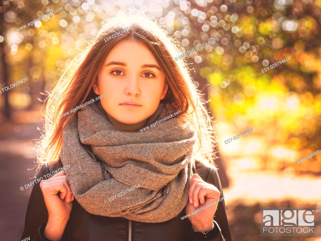 Stock Photo: Beauty young woman posing in the park alley, autumnal female portrait.