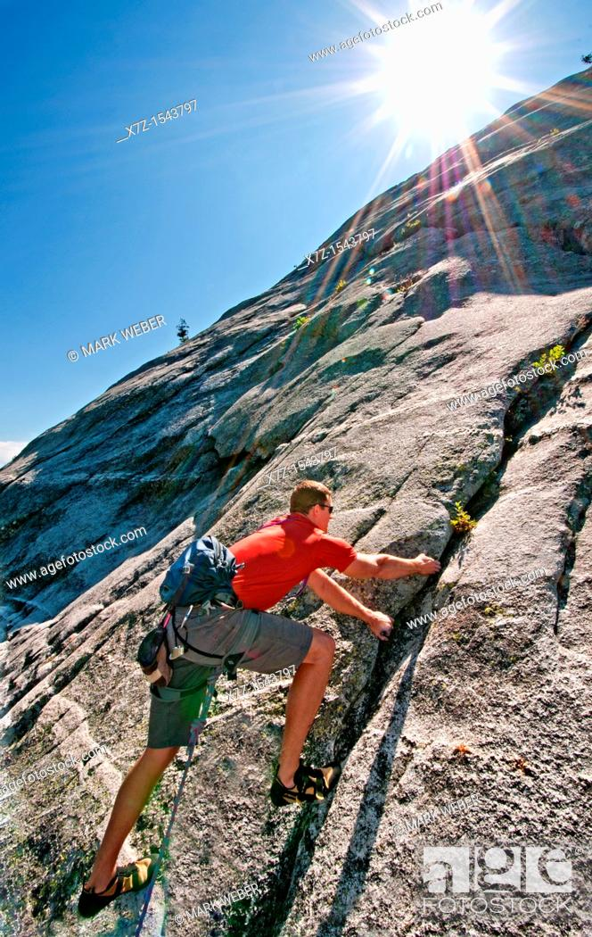 Stock Photo: Rock climbing a route called Memorial which is rated 5,8 and located on Slick Rock near the city of McCall in the Salmon River Mountains of central Idaho.