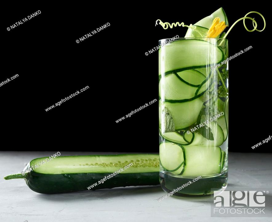 Stock Photo: transparent glass with cucumber pieces, mint leaves and mineral water, healthy lifestyle, detox.