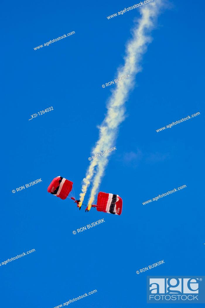 Stock Photo: Red Devils Parachute Regiment Freefall Team performsa at air show at NAS Jacksonville, Florida.