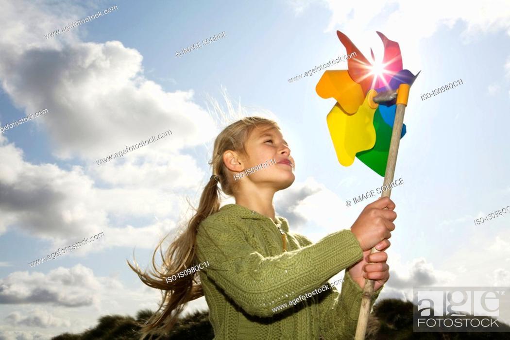 Stock Photo: Girl with a pinwheel.