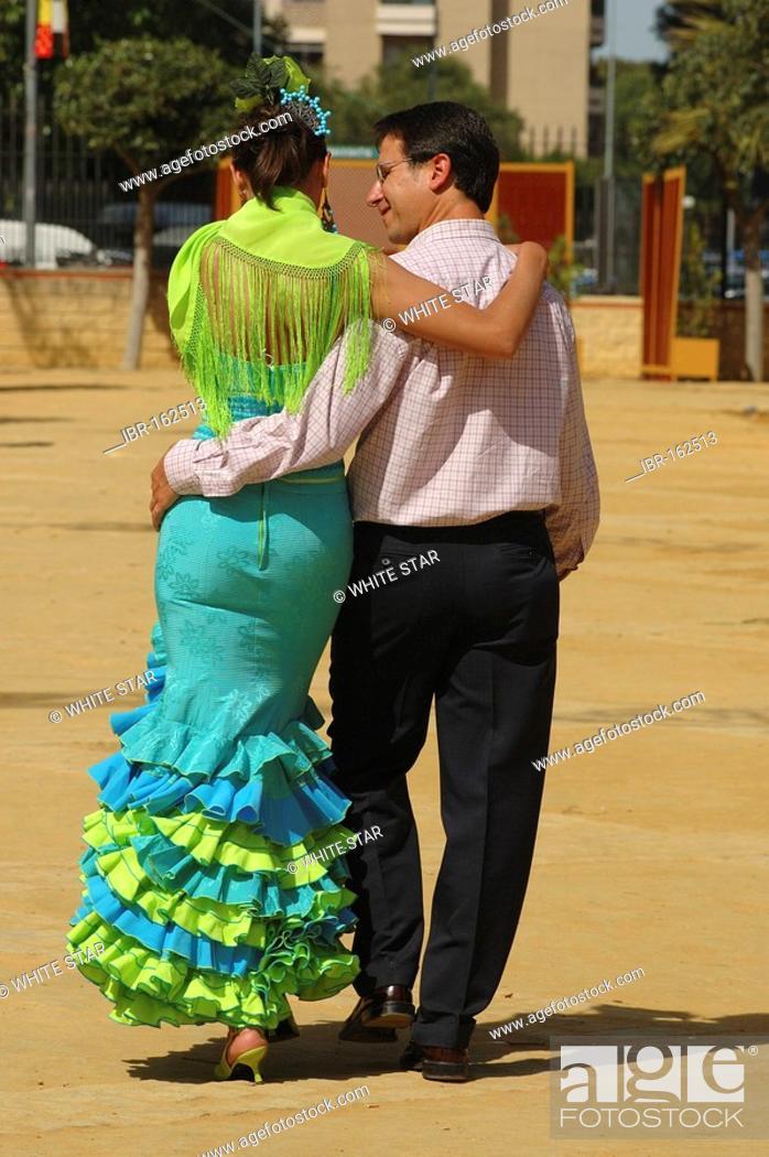 Stock Photo: Girl in traje de gitana with boyfriend , Feria de Caballo , Jerez de la Frontera , Cadiz , Andalusia , Spain , Europe.