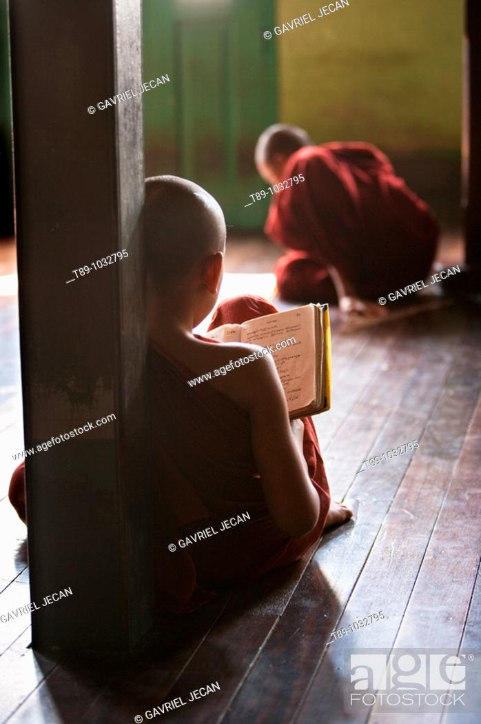 Stock Photo: young monks studing.
