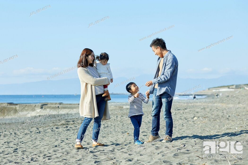 Stock Photo: Japanese family at the beach.