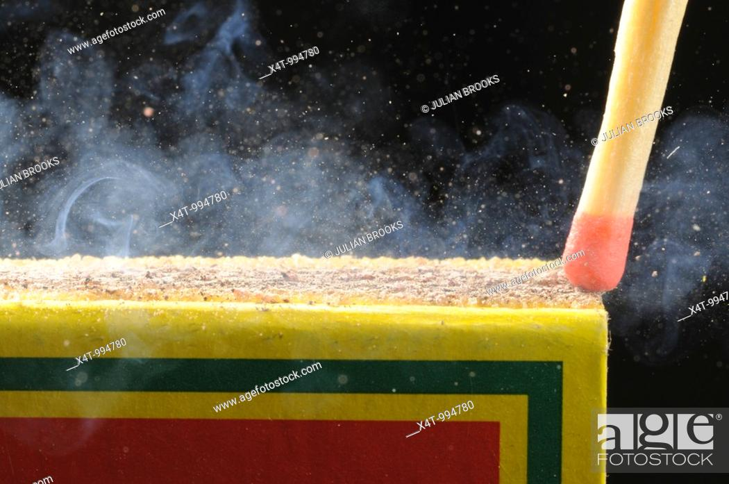 Stock Photo: Striking a match in close up.