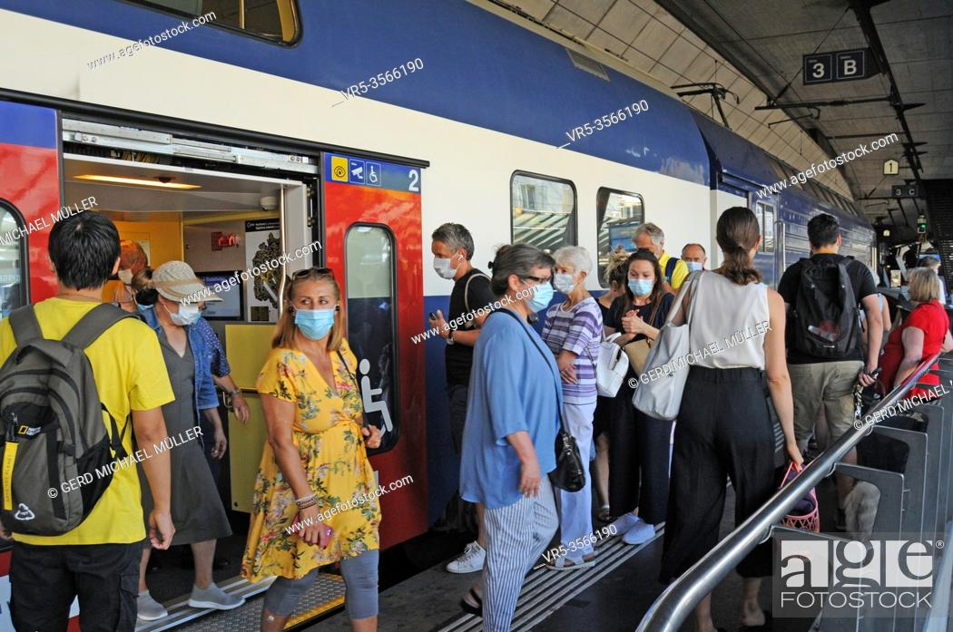 Stock Photo: Switzerland: Face masks are mandatory now on public transport in Switzerland like here in Zürich City.