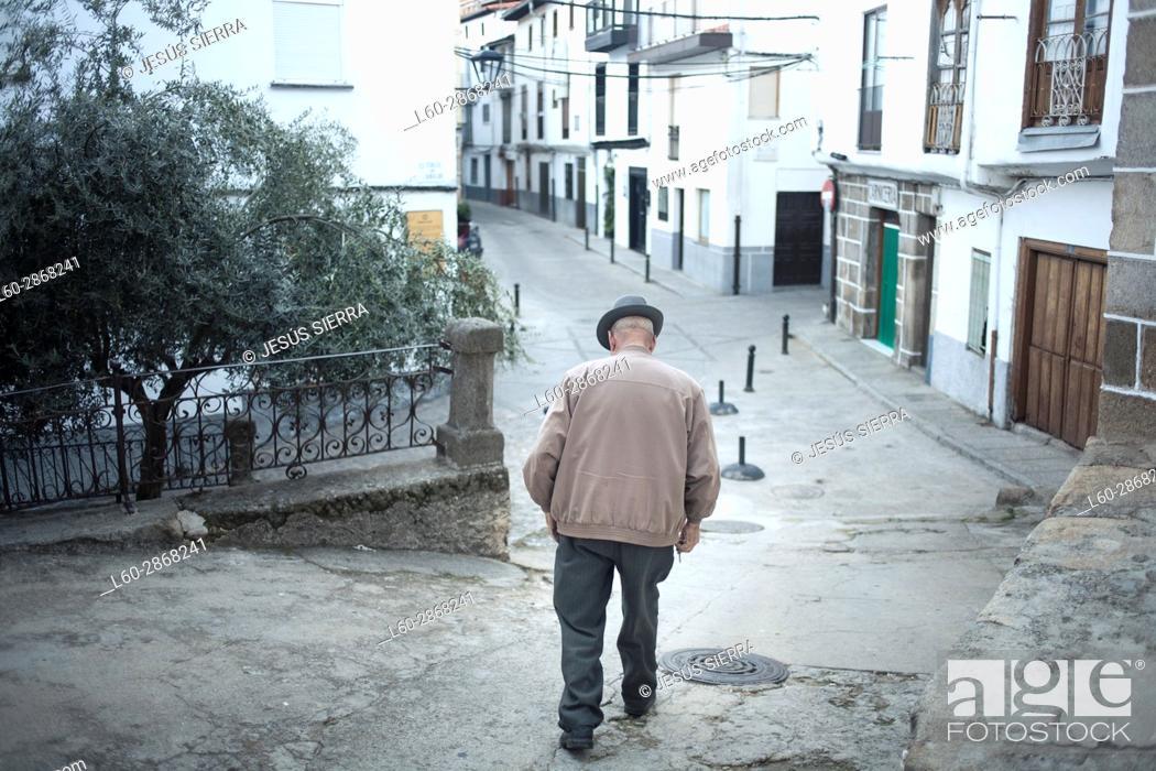 Stock Photo: Old man walking in Hervás, Extremadura, Spain.