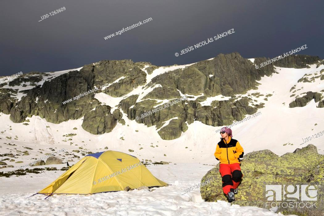 Stock Photo: Mountaineer next to the yellow tent in the Sierra de Béjar Natural Park, in Salamanca province, Biosphere Reserve of Sierra de Béjar and Francia.