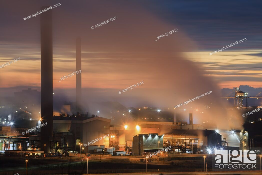 Stock Photo: The Tata Steelworks at Port Talbot, in South Wales, captured during twilight from an inland section of the Wales Coast Path on an evening in mid February.
