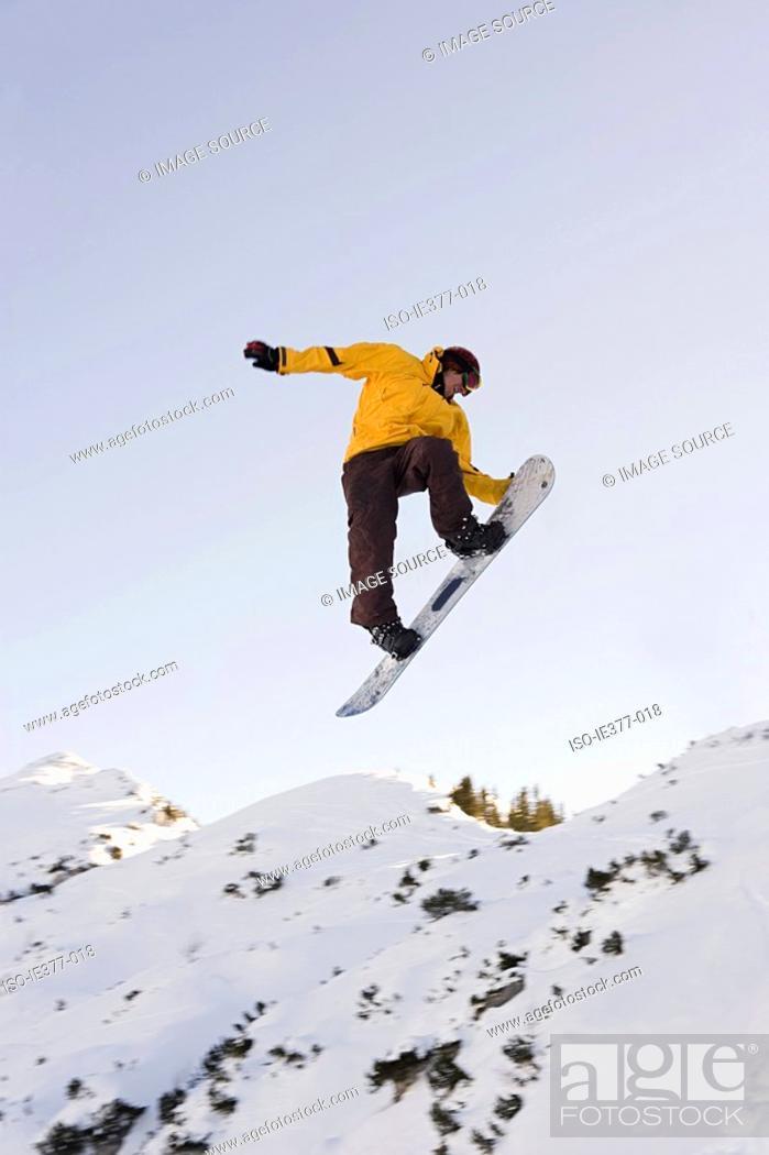 Stock Photo: A man snowboarding.