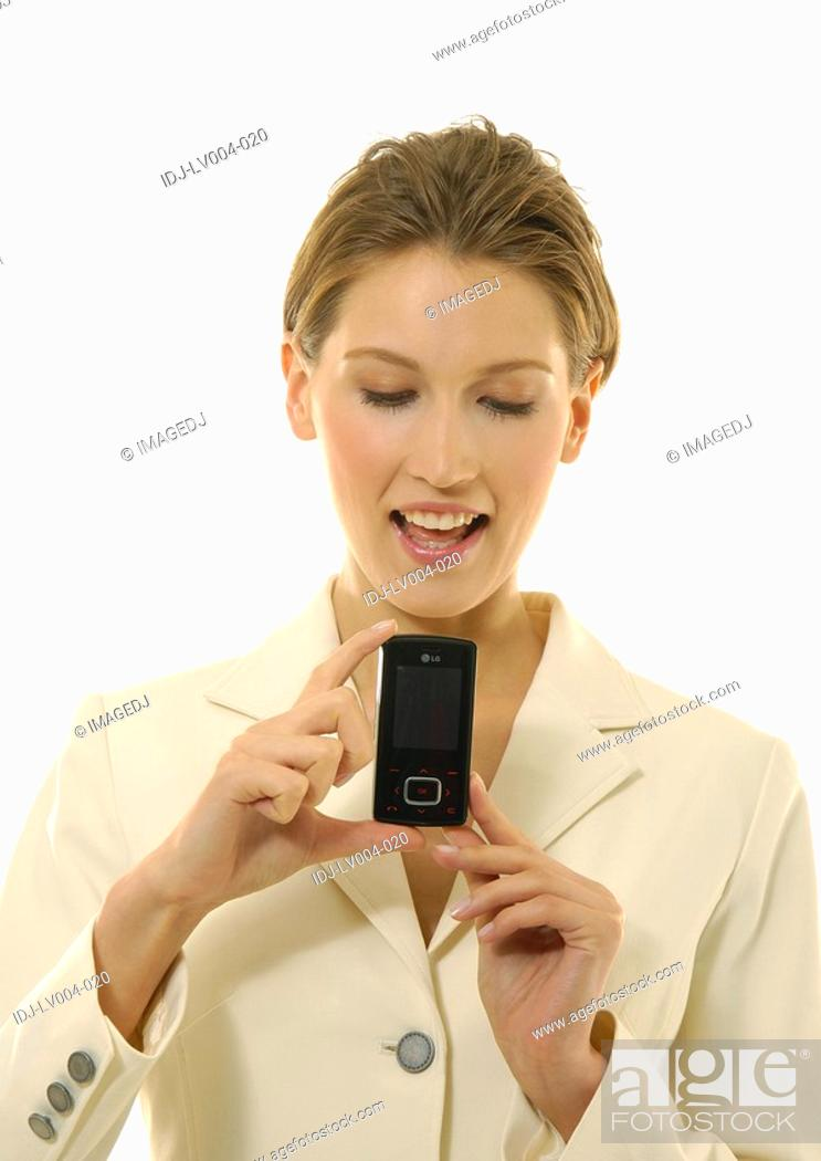 Stock Photo: Close-up of a businesswoman showing a mobile phone.