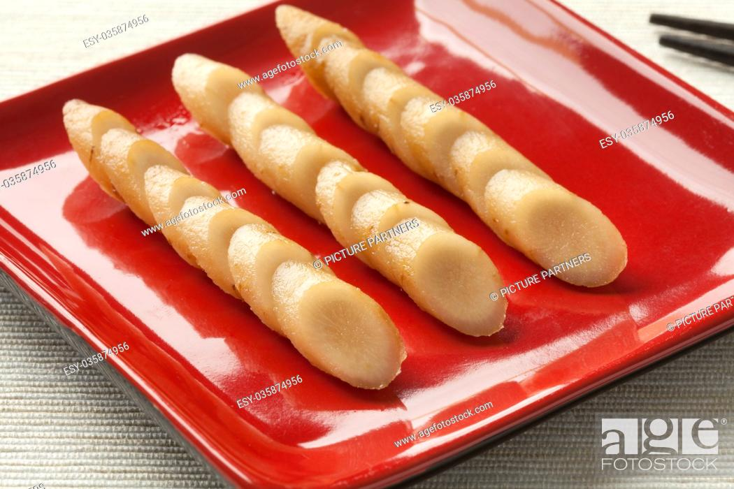 Stock Photo: Dish with sliced Japanese pickled burdock roots called gobo.