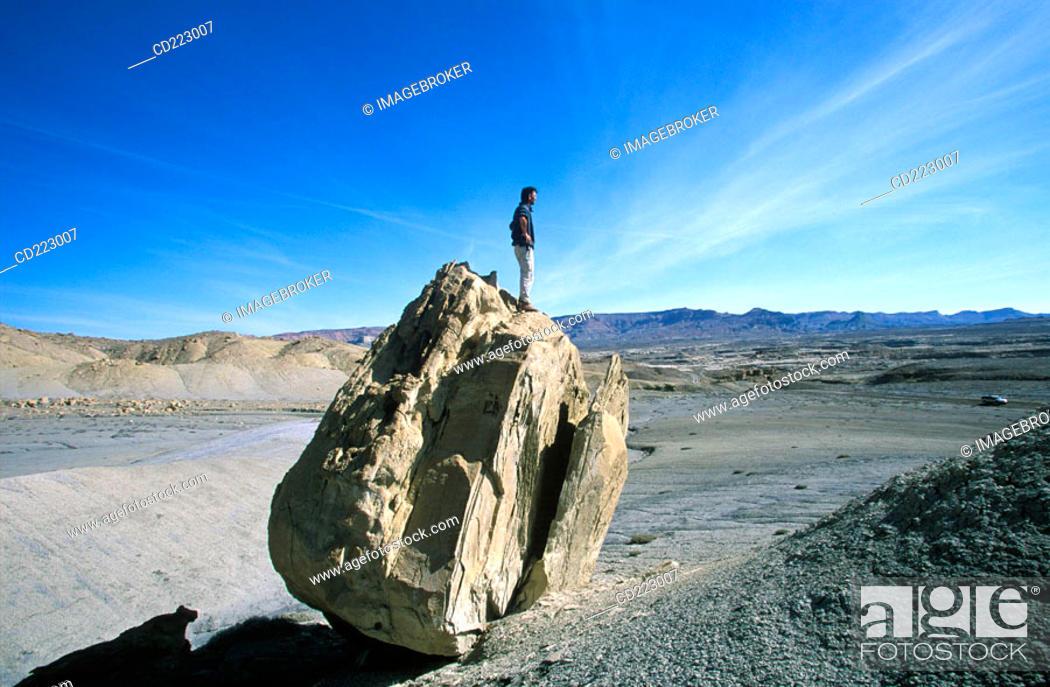 Stock Photo: Man standing on rock, Glen Canyon Area, Utah, USA.