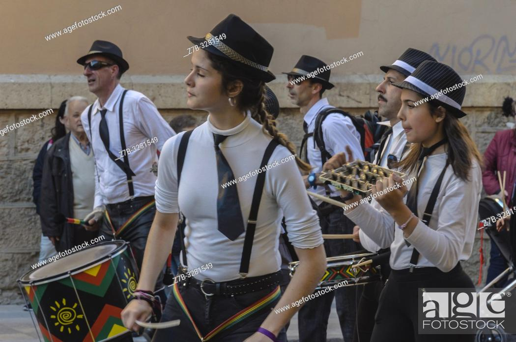 Stock Photo: View of disguises with musicians in Carnival celebrations, Cuenca city, Spain.