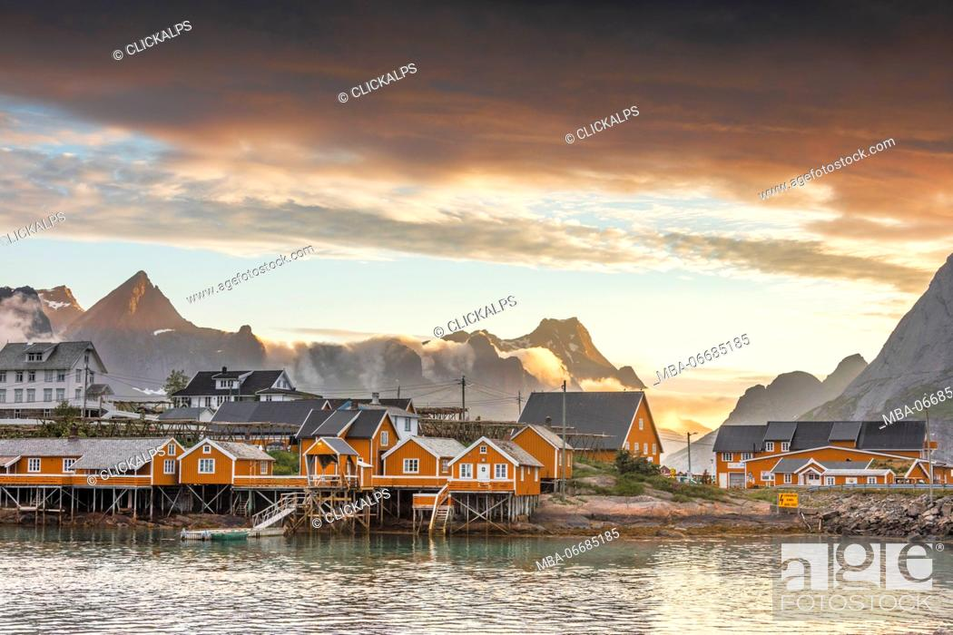 Stock Photo: Sunset on the fishing village frames by rocky peaks and sea Sakrisoya Nordland county Lofoten Islands Northern Norway Europe.