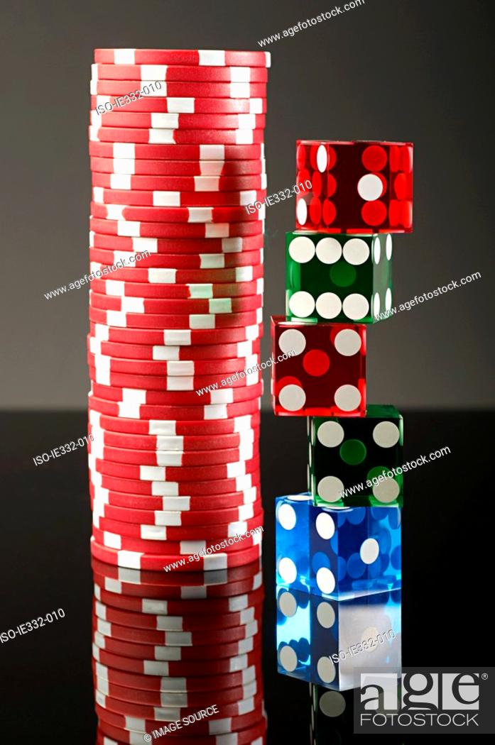 Stock Photo: Stacks of dice and gambling chips.
