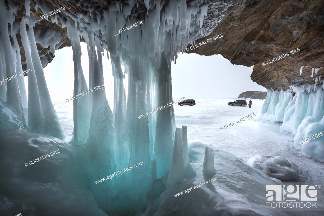 Stock Photo: Ice stalactites in a cave at the shore at lake Baikal, Irkutsk region, Siberia, Russia.