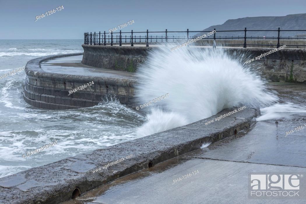 Stock Photo: Waves crashing into the sea wall at Scarborough, North Yorkshire, Yorkshire, England, United Kingdom, Europe.