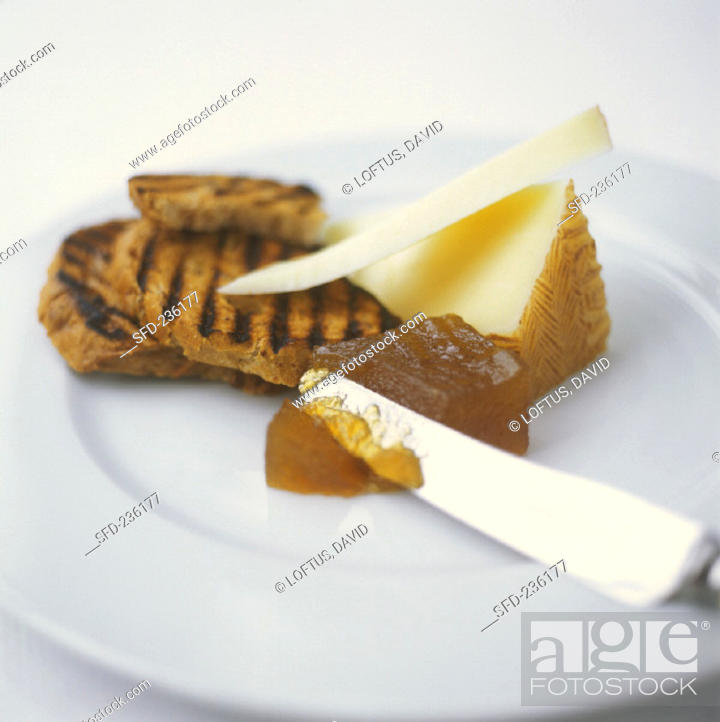 Stock Photo: Quince jelly with cheese on toast.