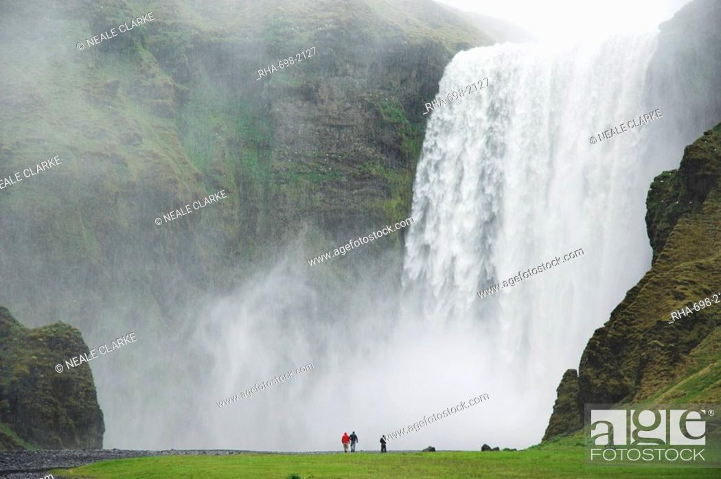 Stock Photo: Tourists at Skogafoss waterfall, Skogar, South area, Iceland, Polar Regions.