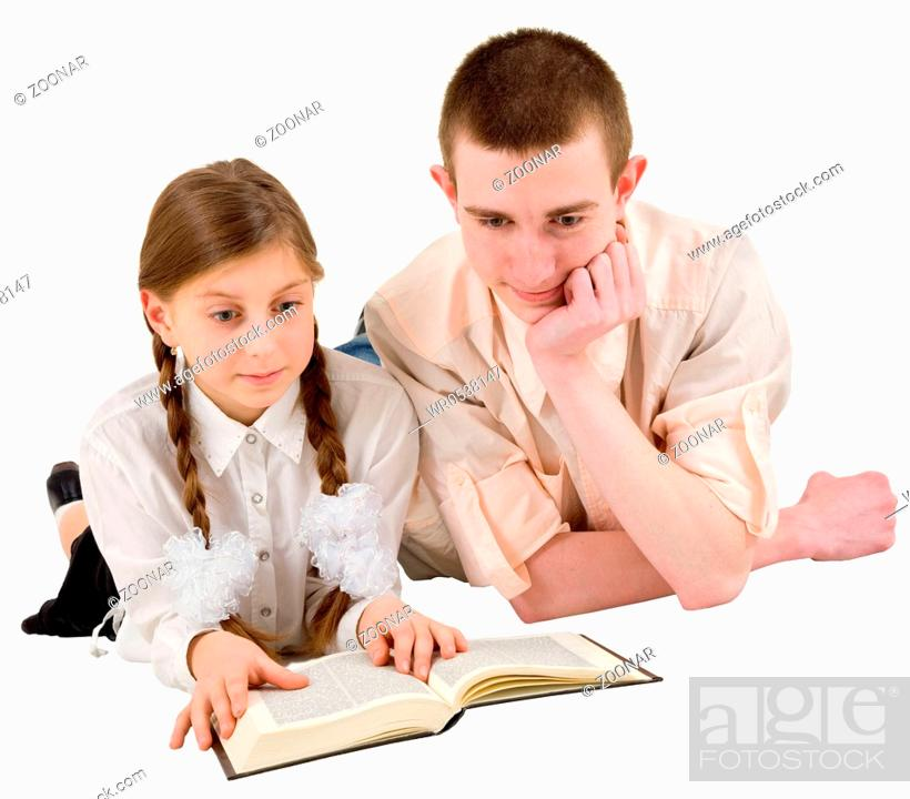 Stock Photo: Man and girl reading book.