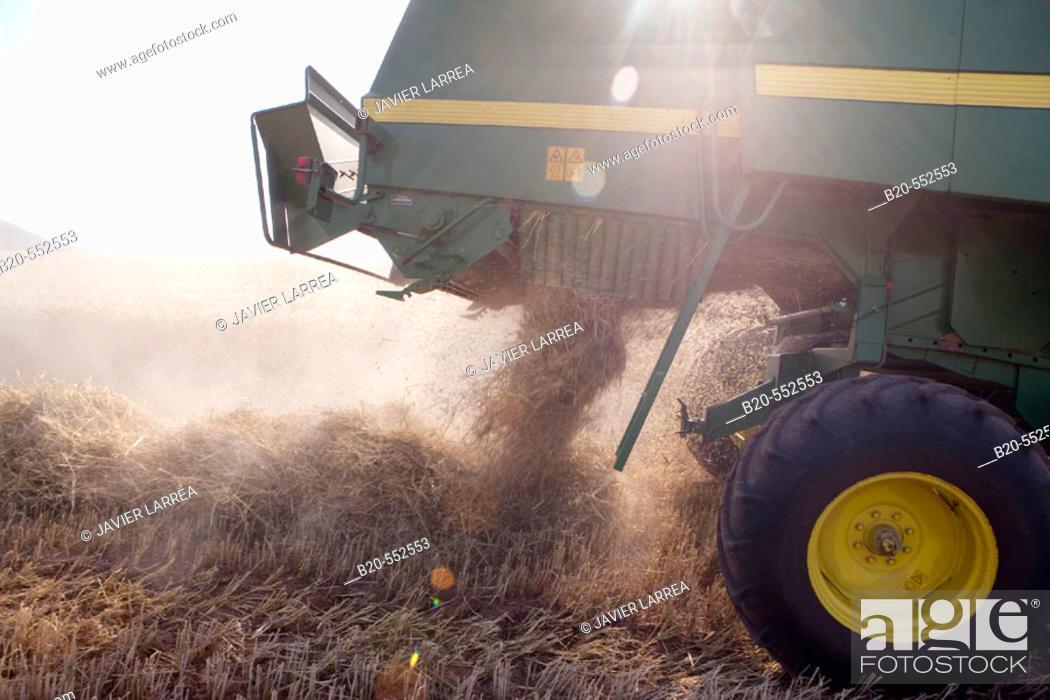 Stock Photo: Agricultural machinery. Combine harvester on field of wheat. 'Learza' estate. Near Estella, Navarre, Spain.
