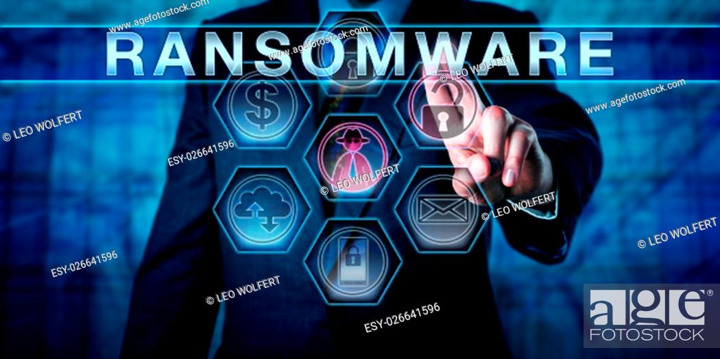 Photo de stock: Male cybersecurity threat systems manager pushing RANSOMWARE on a transparent control interface. Computer crime concept for a hacking attack restricting file.