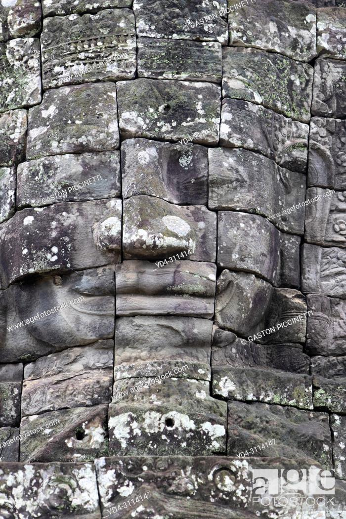 Stock Photo: Stone sculptures, faces on the Bayon Temple in Angkor Thom, Angkor Temple Complex, Siem Reap, Cambodia, Southeast Asia. Bayon is a well-known and richly.
