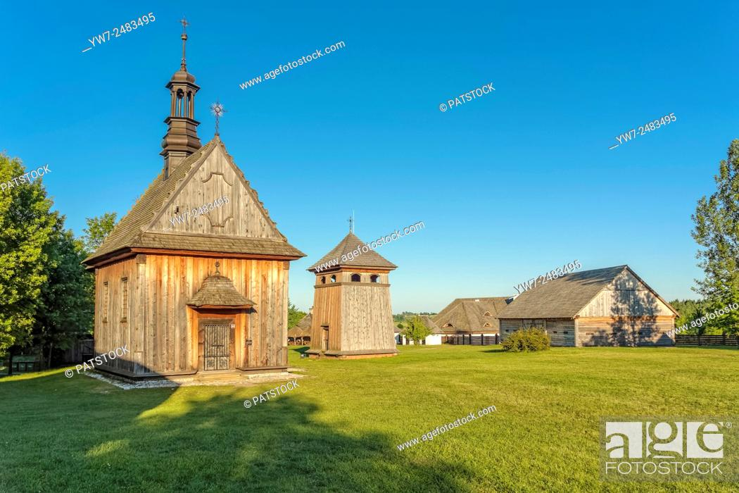 Stock Photo: Church from Rogow and belfry from Kazimierza Wielka in Tokarnia open-air museum, Poland.