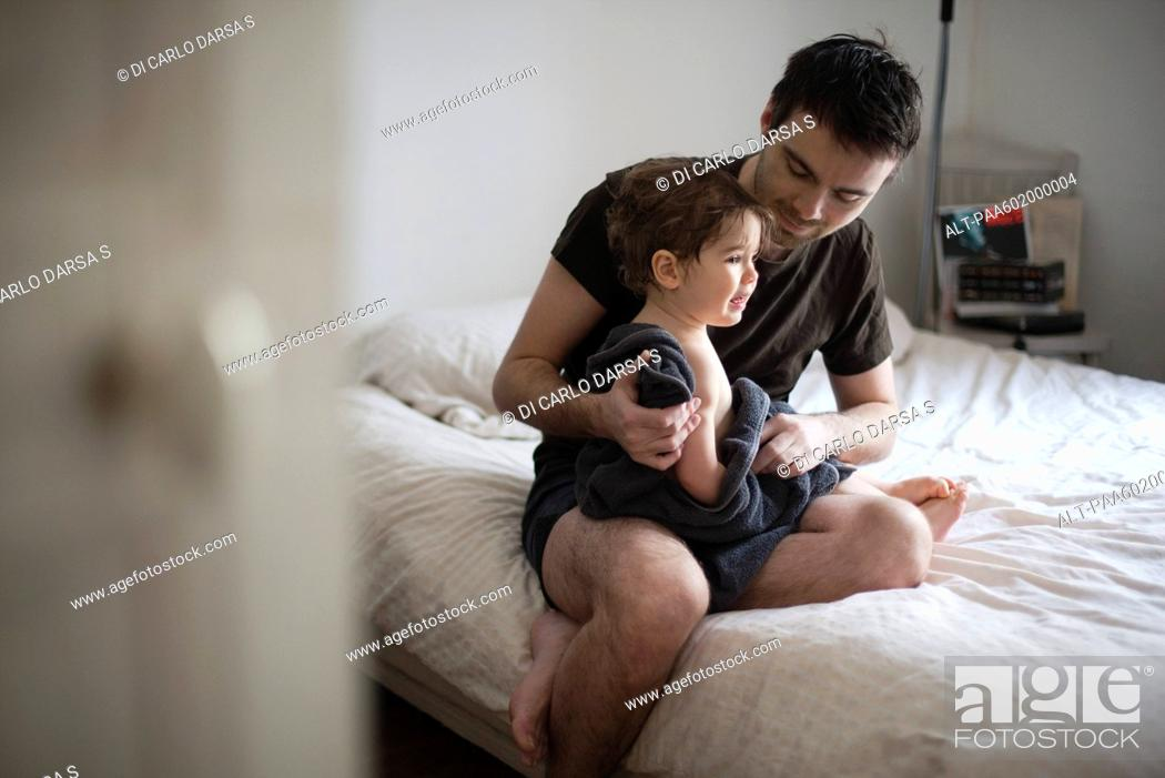 Stock Photo: Father drying off toddler son after a bath.