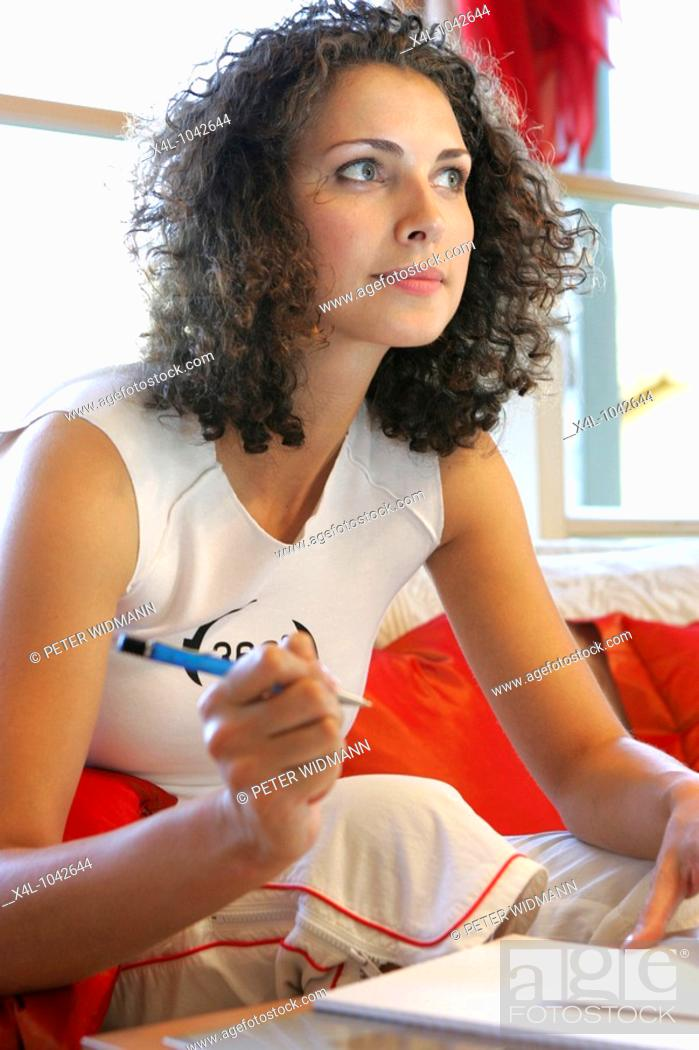 Stock Photo: Young woman writing a letter.