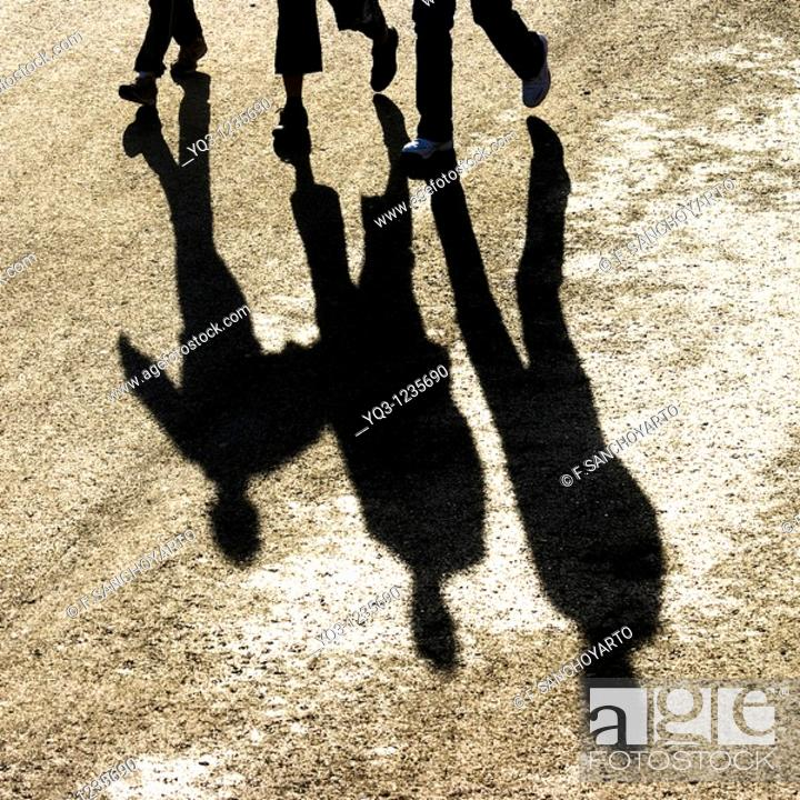 Stock Photo: Pedestrians and their shadows, Castro Urdiales, Cantabria, Spain.