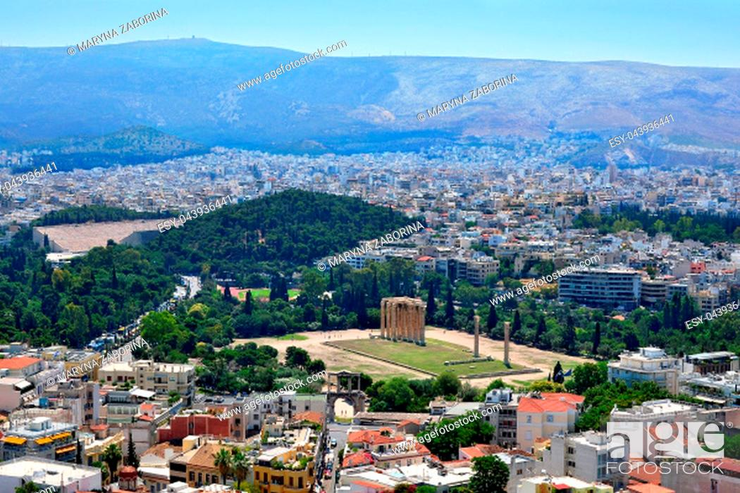 Stock Photo: Panoramic view of Athens and the famous temple of Olympian Zeus from the Acropolis on a summer sunny day.