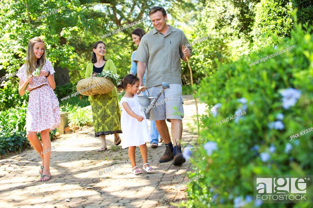 Photo de stock: Happy multi generation family enjoying in the garden.