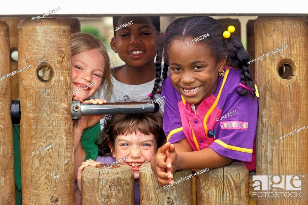 Stock Photo: Detroit, Michigan - Elementary school children on the playground at Friends School in Detroit  MR.