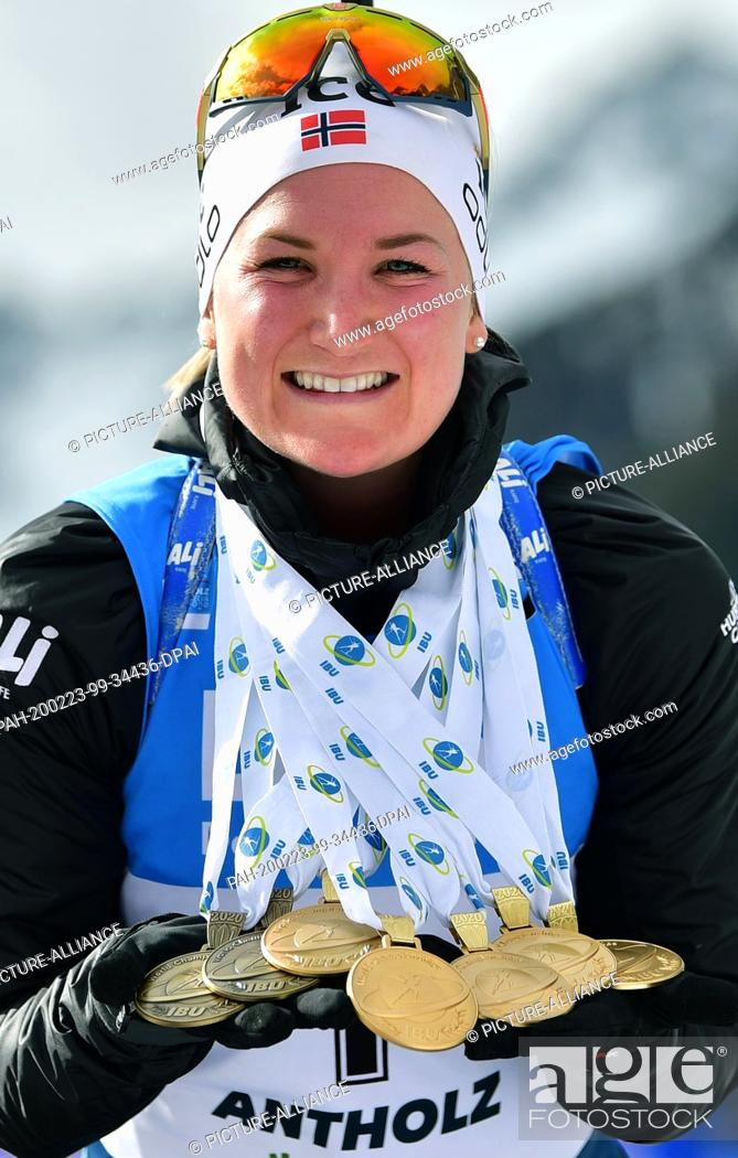 Stock Photo: 23 February 2020, Italy, Antholz: Biathlon: World Championship, mass start 12.5 km, women. Marte Olsbu Roeiseland from Norway shows her five gold and two bronze.
