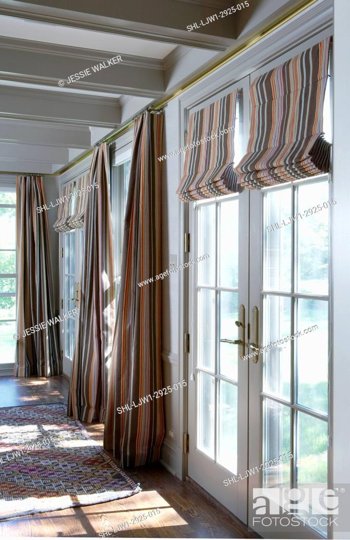 Family Rooms Wall Of Windows And French Doors With Drapes And