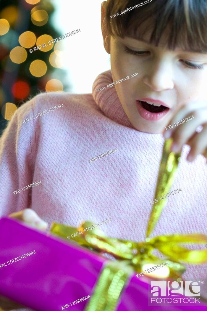 Stock Photo: woman opening present.