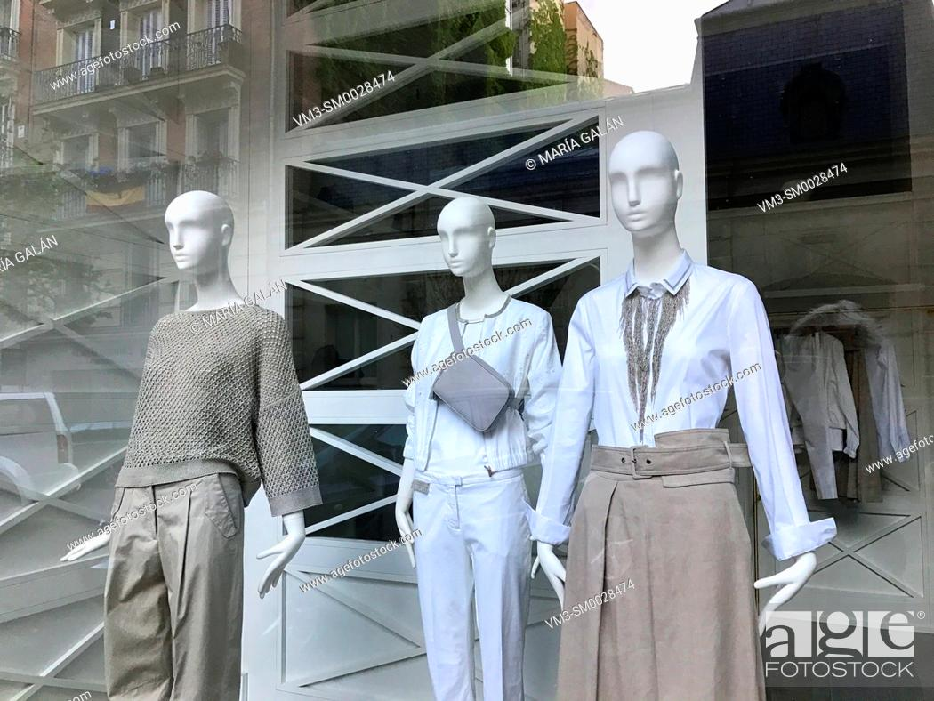 Stock Photo: Three mannequins in a shop window. Madrid, Spain.