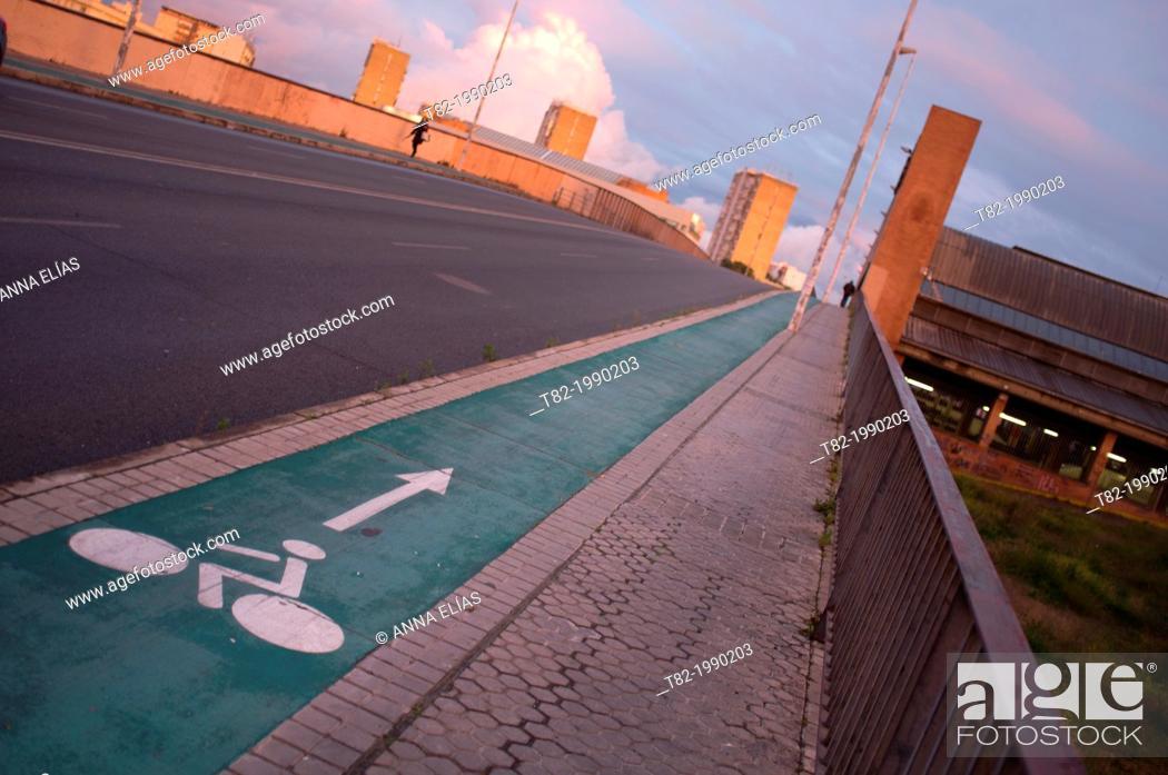 Stock Photo: Bicycle lane on bridge at sunset, Sevilla, Andalucia, Spain.
